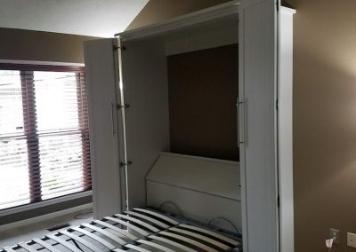 bedroom_murphy beds_white bifold with shaker doors open